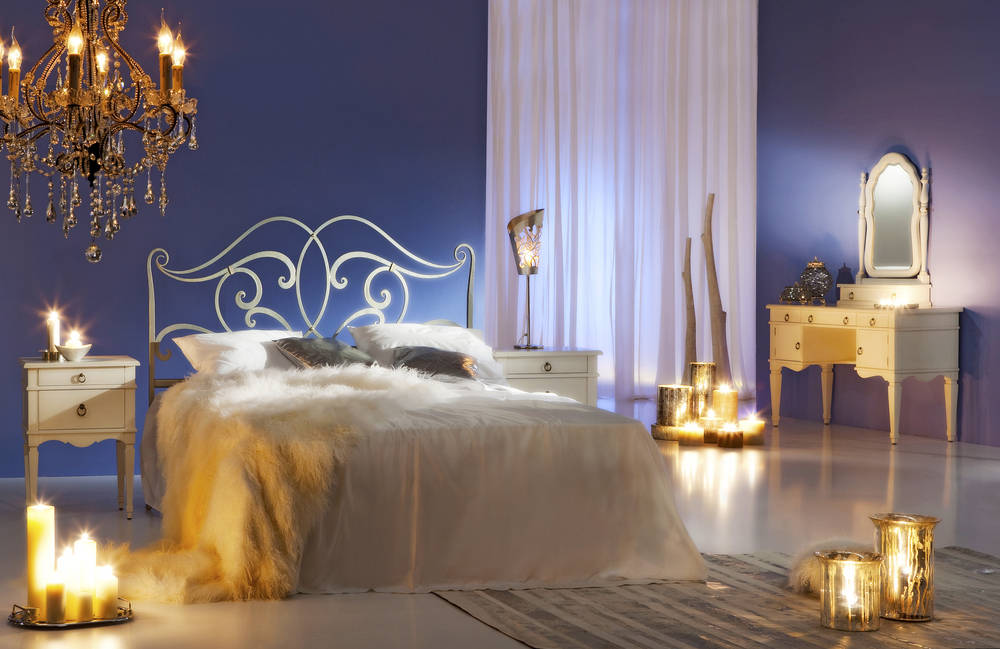Purple dream bedroom with candles